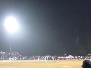 The opposing team and fans crowd onto the field after defeating the Bremen Bulldogs in their final game of the season.