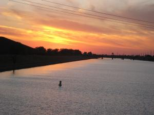 The sun setting on the Oklahoma River - future site of a training facility for U.S. Olympic Crew from what I hear..