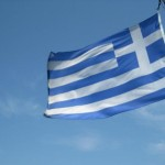 Greek flag flying on the Acropolis.