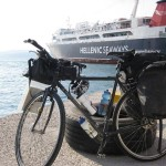 This is the boat that took us from Piraeus (Athens) to Poros; in the foreground you will notice that my bike now has MTB handlebars, new (bigger) Schwalbe Marathon tires, and a 3rd water bottle. Or you won't.