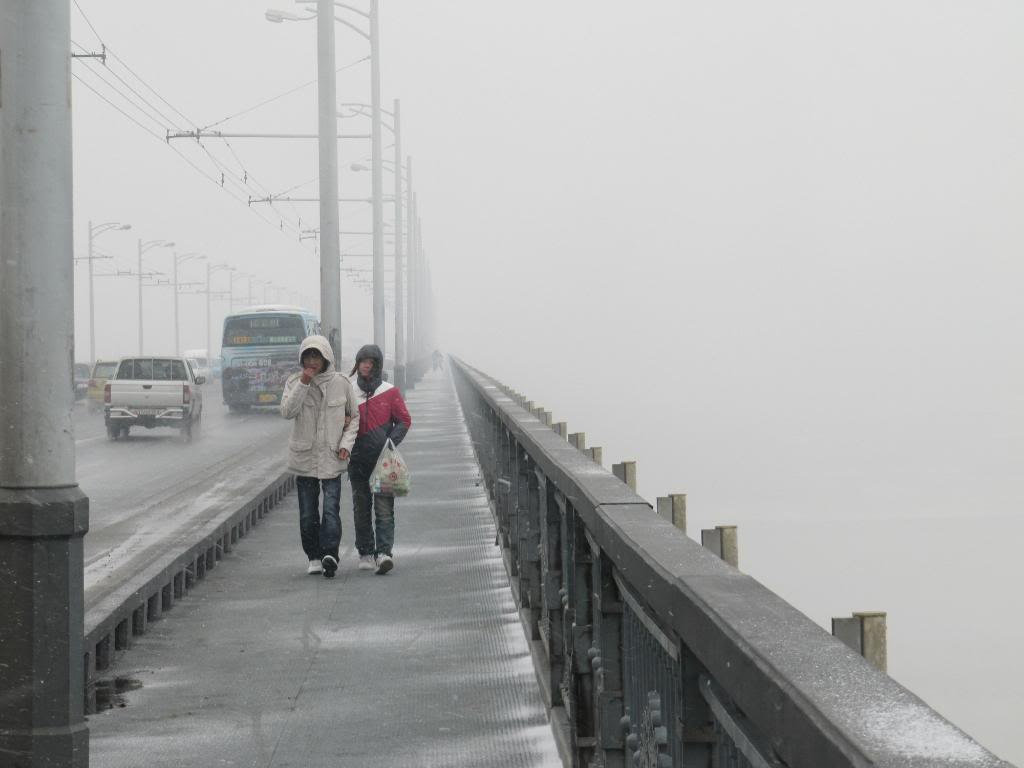 Crossing the Yangze River to go meet George.  Day before my seizure.  It was really cold.