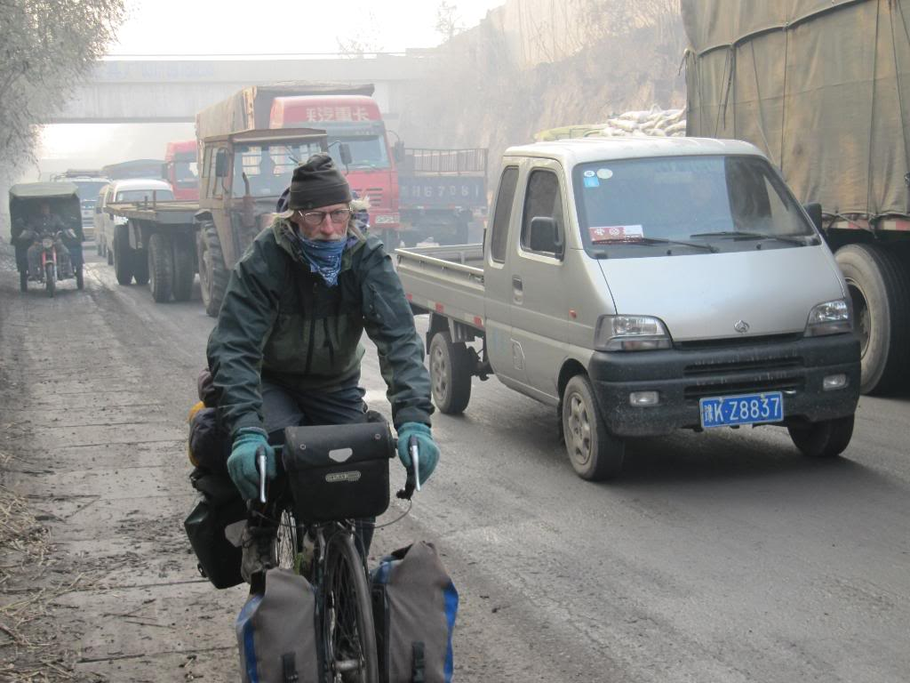 George pedaling through heavy traffic outside Zhengzhou, China