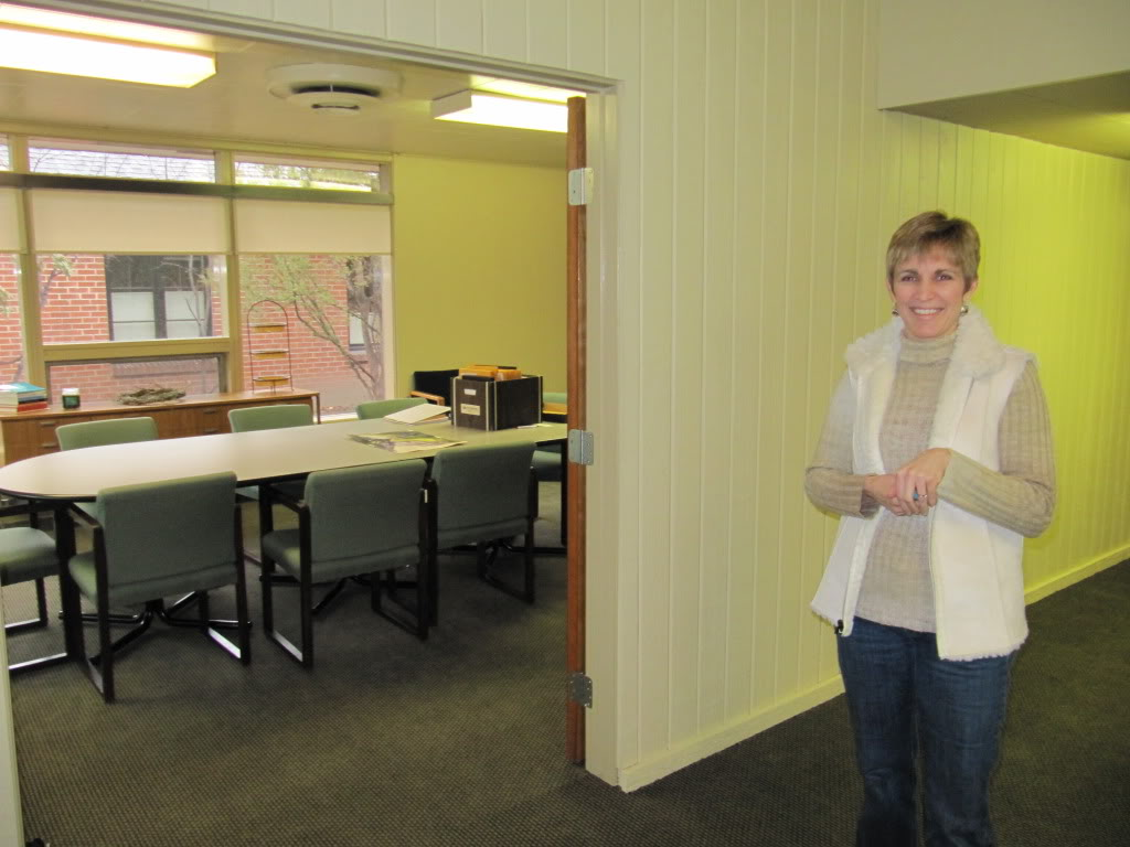 Debbie Snow, showing off the newly-remodeled conference room at the Epilepsy Foundation Offices in Boise, Idaho.  Debbie has epilepsy.