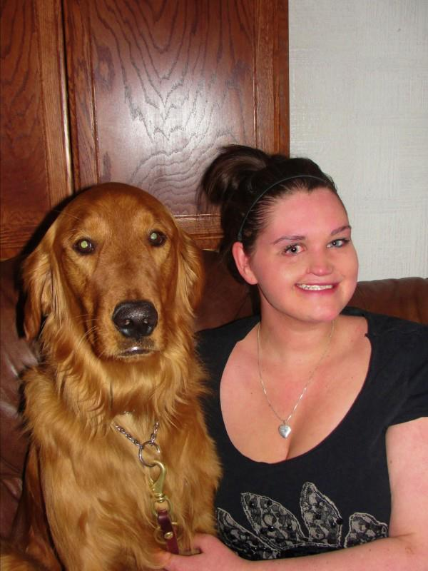 Kelley Sperry with her new seizure response dog, Kobi.