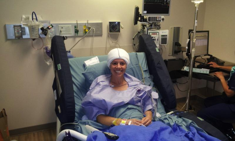 "Jessica is shown here at the Mayo Clinic in Phoenix, ready for surgery to remove her right temporal lobe.  At this stage, she had already undergone one surgery to implant depth electrodes to locate the focal point of her seizures.  She remembers cheerfully that she wore that head wrap for ""quite a while."""