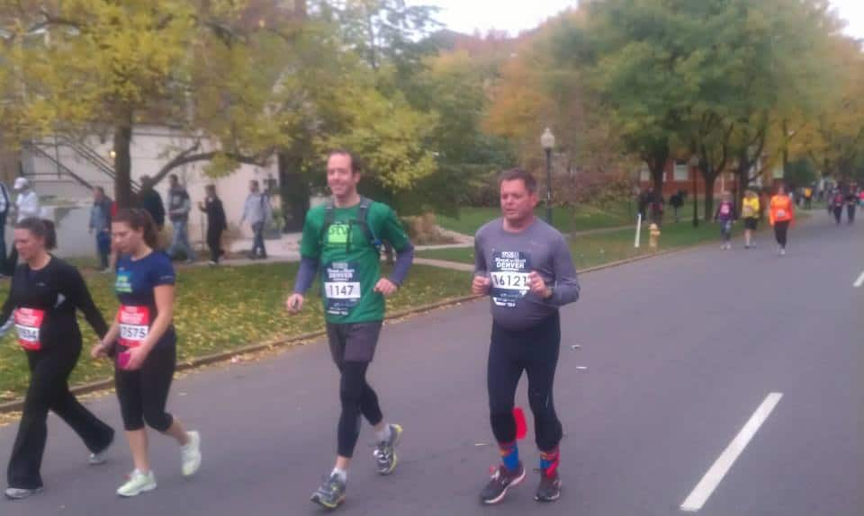 Brad Rinehart running with Charles Koller on 17th st. in the Rock 'n' Roll Marathon.  Charles helped Brad with training and preparation for the marathon.